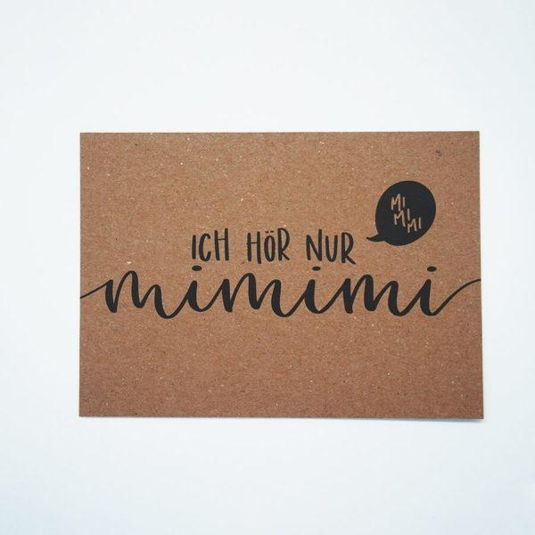 """Postkarte aus Kraftkarton mit schwarzer Aufschrift """"Ich hör nur mimimi"""" vor weißem Hintergrund."""