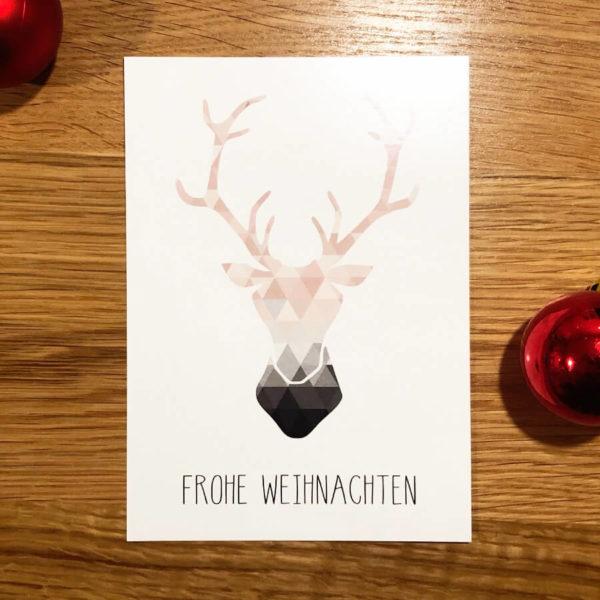 """Karte mit Rentier und Aufschrift """"Frohe Weihnachten"""" in modernem Design"""